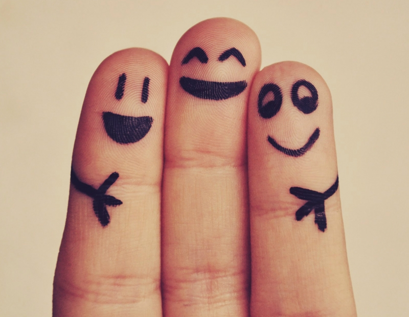 Fingers with happy faces