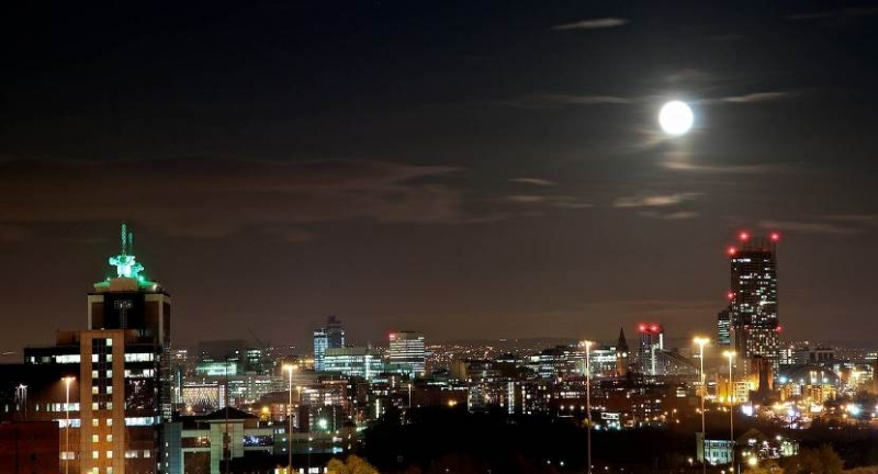 Manchester buldings lighting up in the dark sky