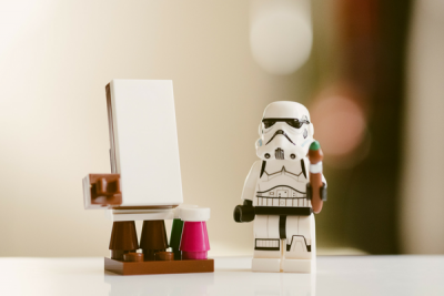 Stormtrooper next to an easel