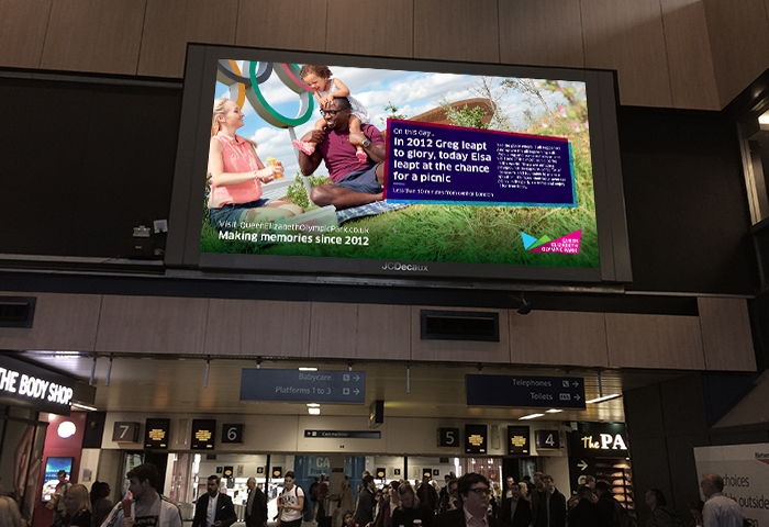 Euston tickethall with QEOP advertising